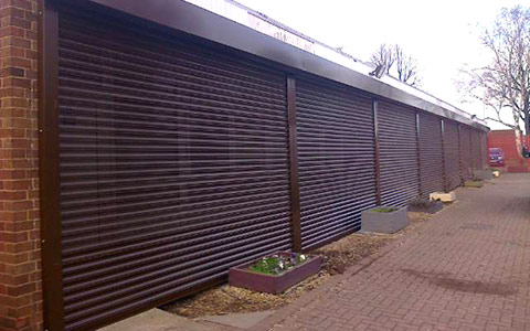 electrically operated perforated vision roller shutters