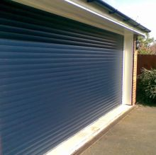 blue roller shutter on garage