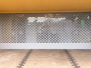 punched and glazed aluminium roller shutter front view