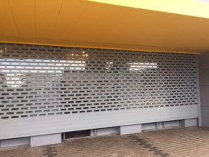 punched and glazed aluminium roller shutter raised