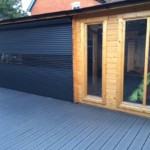 compact aluminium roller shutter glazed and finished in black