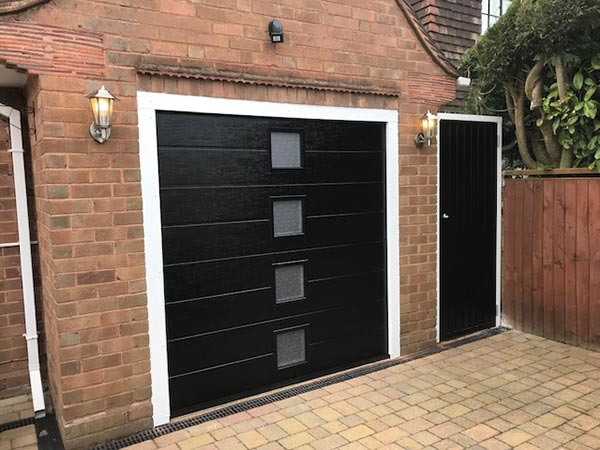 insulated sectional garage door with side entrance