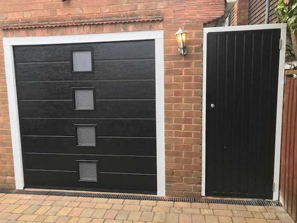 insulated sectional garage door with side entrance 1