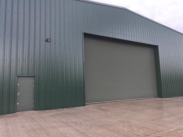large bespoke hanger roller shutter and personnel access door