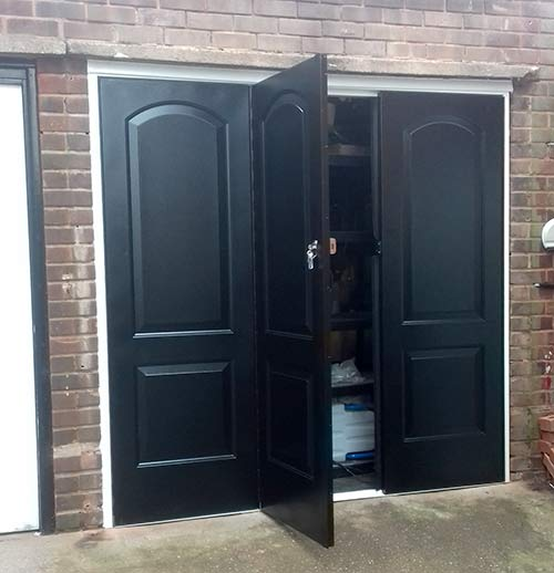 bi-fold centre door garage open