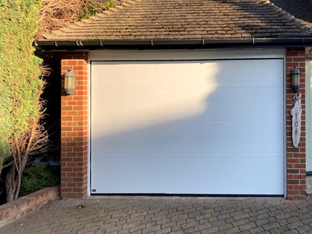 sws insulated sectional L-ribbed garage door & frame