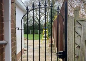 solid-steel garden gate to side