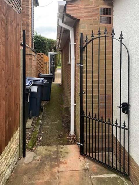 solid-steel garden gate open