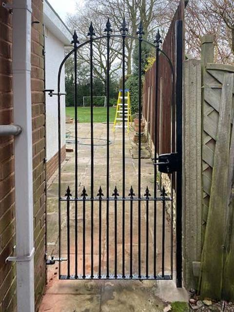solid-steel garden gate to side