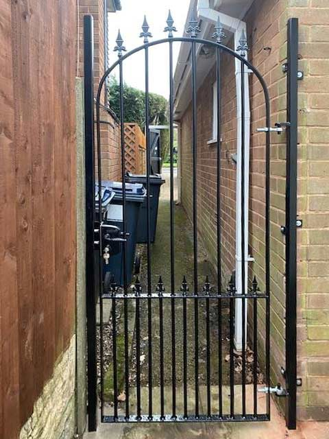 solid-steel garden gate to front